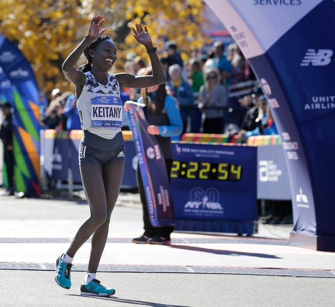 Mary Keitany of Kenya celebrates after winning the women's division of the New York City Marathon on Nov. 4.
