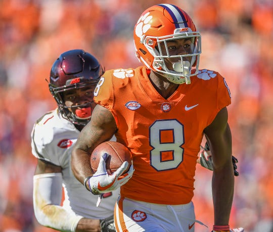 Clemson wide receiver Justyn Ross (8) catches a TD past Louisville cornerback P.J. Mbanasor (1) during the 3rd quarter Saturday, November 3, 2018 at Clemson's Memorial Stadium.