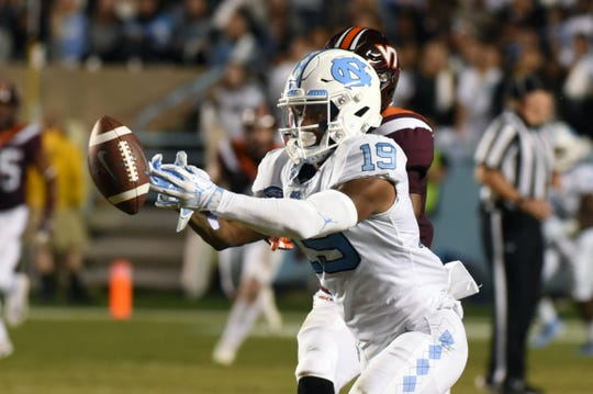 Oct 13, 2018; Chapel Hill, NC, USA; A pass falls incomplete in front of North Carolina Tar Heels wide receiver Dazz Newsome (19) during the first half at Kenan Memorial Stadium. Mandatory Credit: Rob Kinnan-USA TODAY Sports
