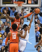 Clemson forward Elijah Thomas (14) blocks the shot of North Carolina guard Joel Berry II (2) on Tuesday, January 14, 2018 at UNC's Smith Center in Chapel Hill, N.C.