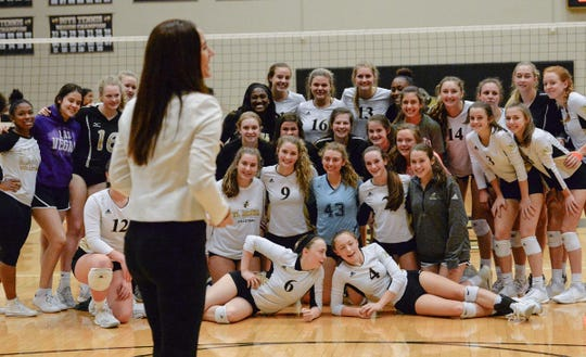 TL Hanna get together for a group photo after the Yellow Jackets won a Region 1-AAAAA match earlier this season at home.