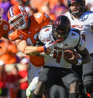 Clemson linebacker Chad Smith (43) sacks Louisville quarterback Jawon Pass (4) during the 3rd quarter Saturday, November 3, 2018 at Clemson's Memorial Stadium.