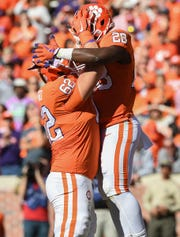 Clemson running back Tavien Feaster (28) celebrates with offensive lineman Cade Stewart (62) after scoring against Louisville during the 3rd quarter Saturday, November 3, 2018 at Clemson's Memorial Stadium.