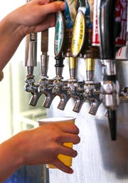 Pineville residents voted to allow restaurants to sell alcohol in 2013. Propositions on the Dec. 8 ballot could see the city's alcohol regulations changed, including the possibility that alcohol could be taken out of restaurants.