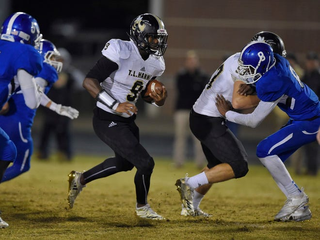 Senior Jay Lagroon (9) and the unbeaten T.L. Hanna Yellow Jackets will host Spartanburg in the first round of the Class AAAAA playoffs Friday night.