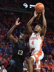 Clemson guard Shelton Mitchell (4) drives to the basket past Pitt guard Khameron Davis (13) during the 1st half on Thursday, February 8,  2018 at Clemson's Littlejohn Coliseum.