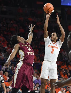 Clemson guard Marcquise Reed (2) shoots over Florida State guard Terance Mann (14) during the 1st half on Wednesday, February 28,  2018 at Clemson's Littlejohn Coliseum.