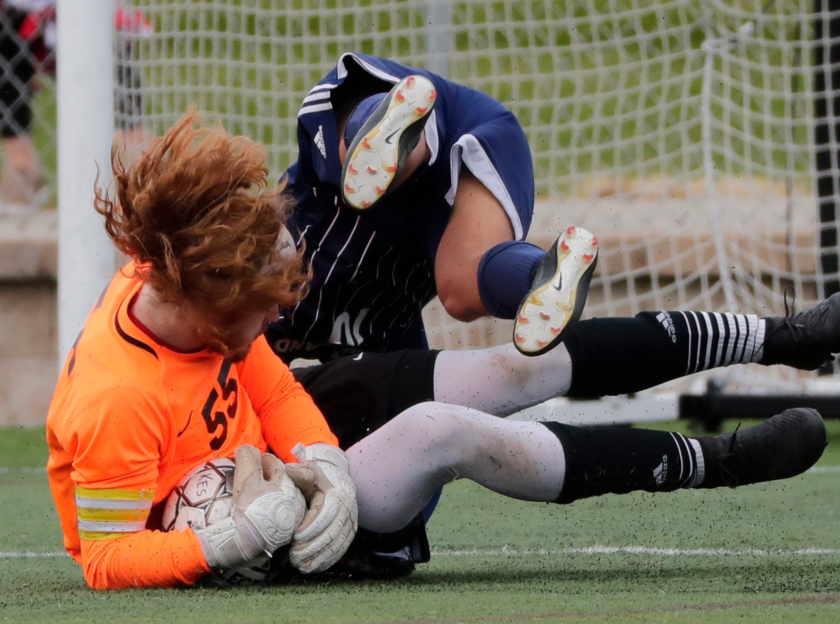 Plymouth High School's Gabe Thull (55) makes a save as he collides with McFarland High School's Juan Torres (16) during their WIAA Division 3 state semifinal boys soccer game Thursday, November 1, 2018, at Uihlein Soccer Park in Milwaukee, Wis. 