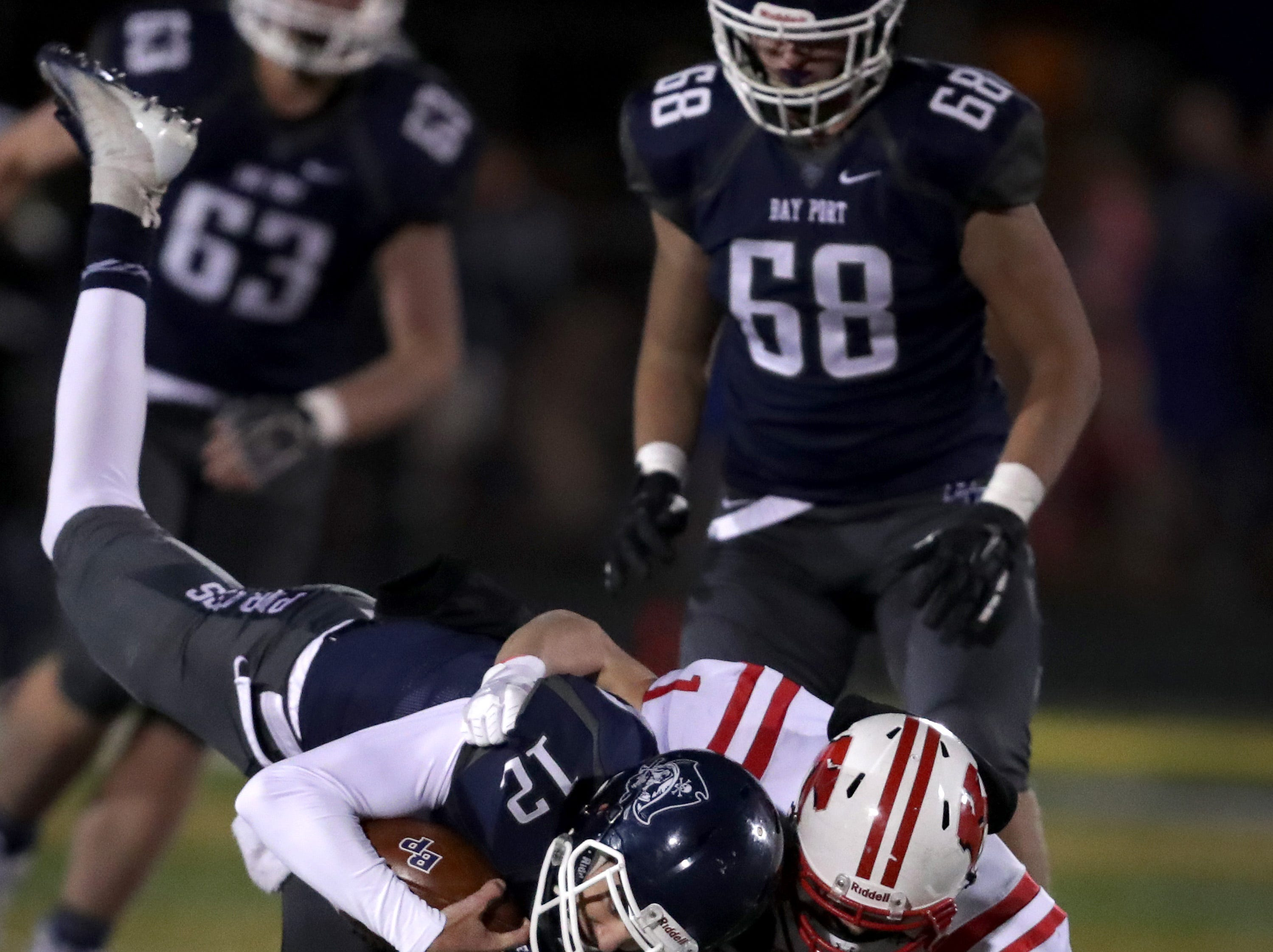 Bayport High School's #12 Andrew Thomas is tackled by Kimberly High School's #1 Caleb Obermann during their WIAA Division 1 state quarterfinal football game on Friday, November 1, 2018, in Green Bay, Wis.  Kimberly defeated Bayport 38 to 20.