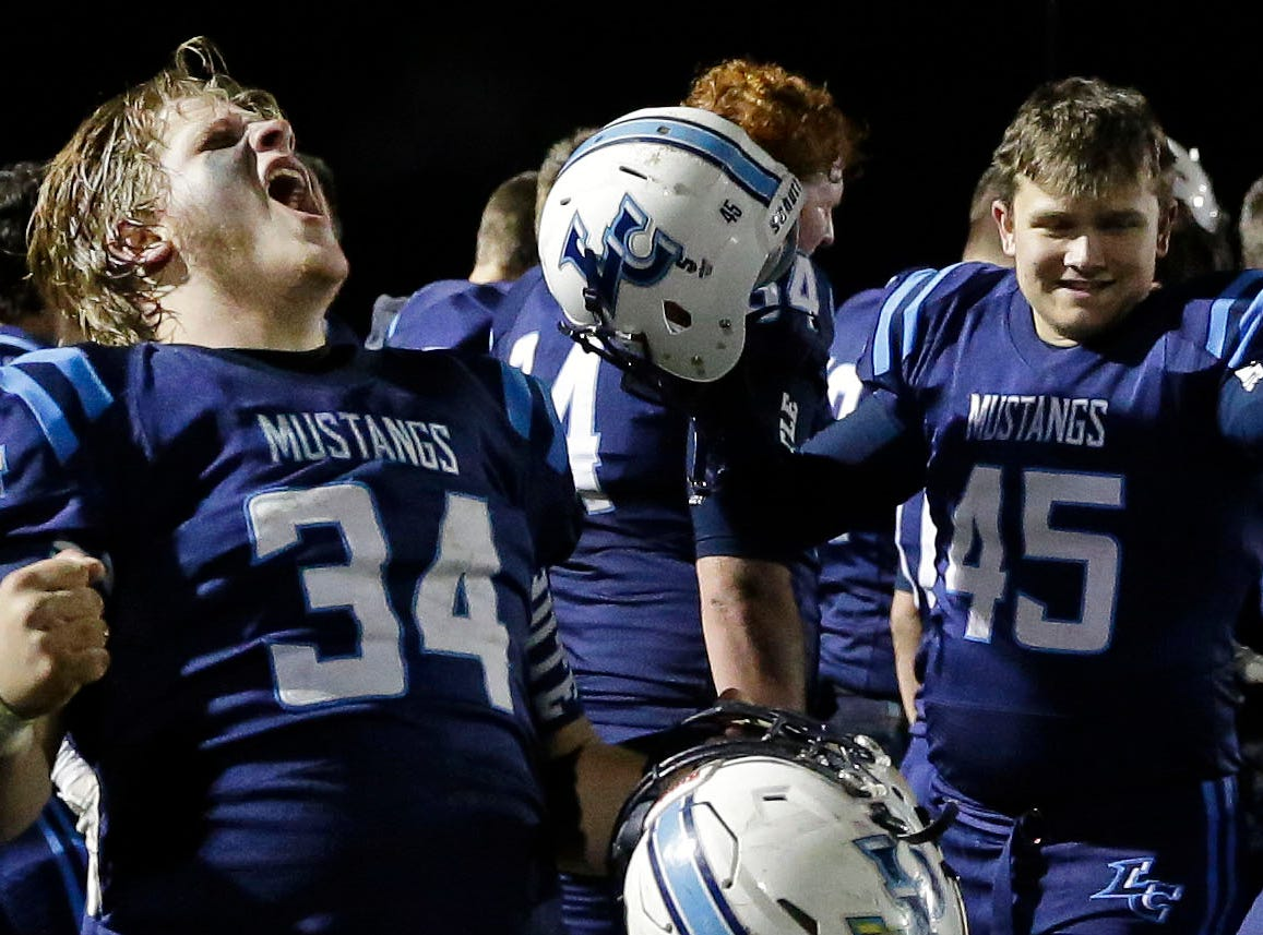 Thomas Mayefski of Little Chute celebrates a win against Wrightstown in a WIAA Division 4 Level 3 playoff game Friday, November 2, 2018, at Fitzpatrick Field in Little Chute, Wis.