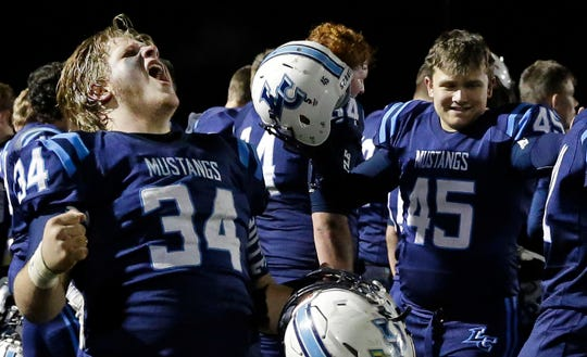 Thomas Mayefski of Little Chute celebrates a win against Wrightstown in a WIAA Division 4 playoff game Friday at Fitzpatrick Field in Little Chute.