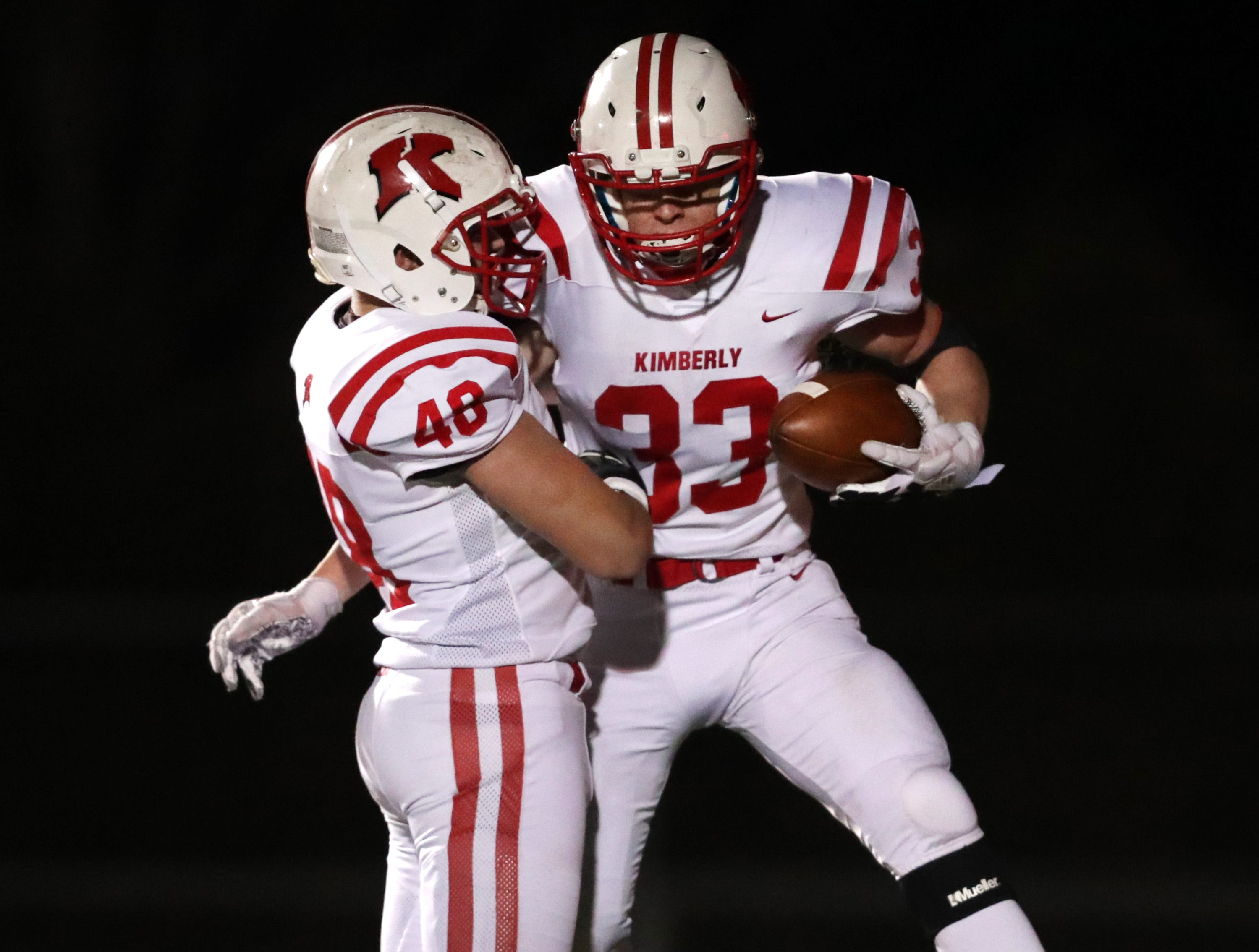 Kimberly High School's #33 Caleb Frazer and #48 Will Hammen celebrate a fourth quarter touchdown against Bayport High School during their WIAA Division 1 state quarterfinal football game on Friday, November 1, 2018, in Green Bay, Wis.  Kimberly defeated Bayport 38 to 20.