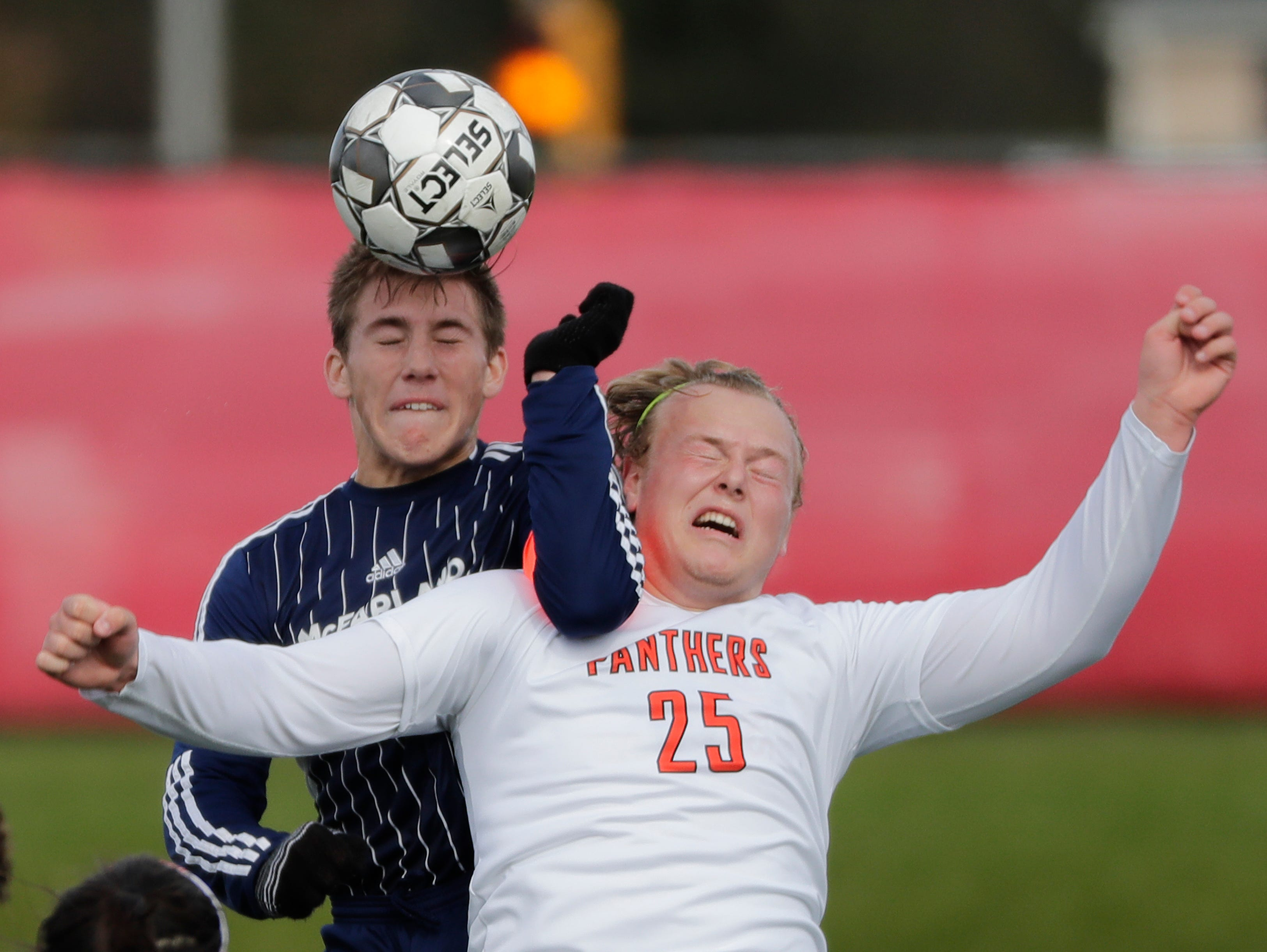 Plymouth High School's Joel Williams (25) defends against McFarland High School's Caleb Blair (10) during their WIAA Division 3 state semifinal boys soccer game Thursday, November 1, 2018, at Uihlein Soccer Park in Milwaukee, Wis. 
