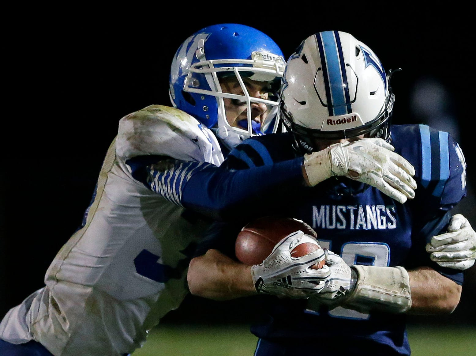 Jacob Lillge of Little Chute is tackled by Jeremy Van Zeeland of Wrightstown in a WIAA Division 4 Level 3 playoff game Friday, November 2, 2018, at Fitzpatrick Field in Little Chute, Wis.