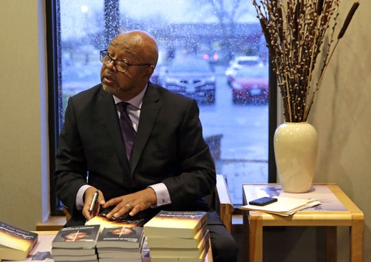 Columnist and author Leonard Pitts Jr. signs books Sunday before the ESTHER banquet at Liberty Hall in Kimberly.