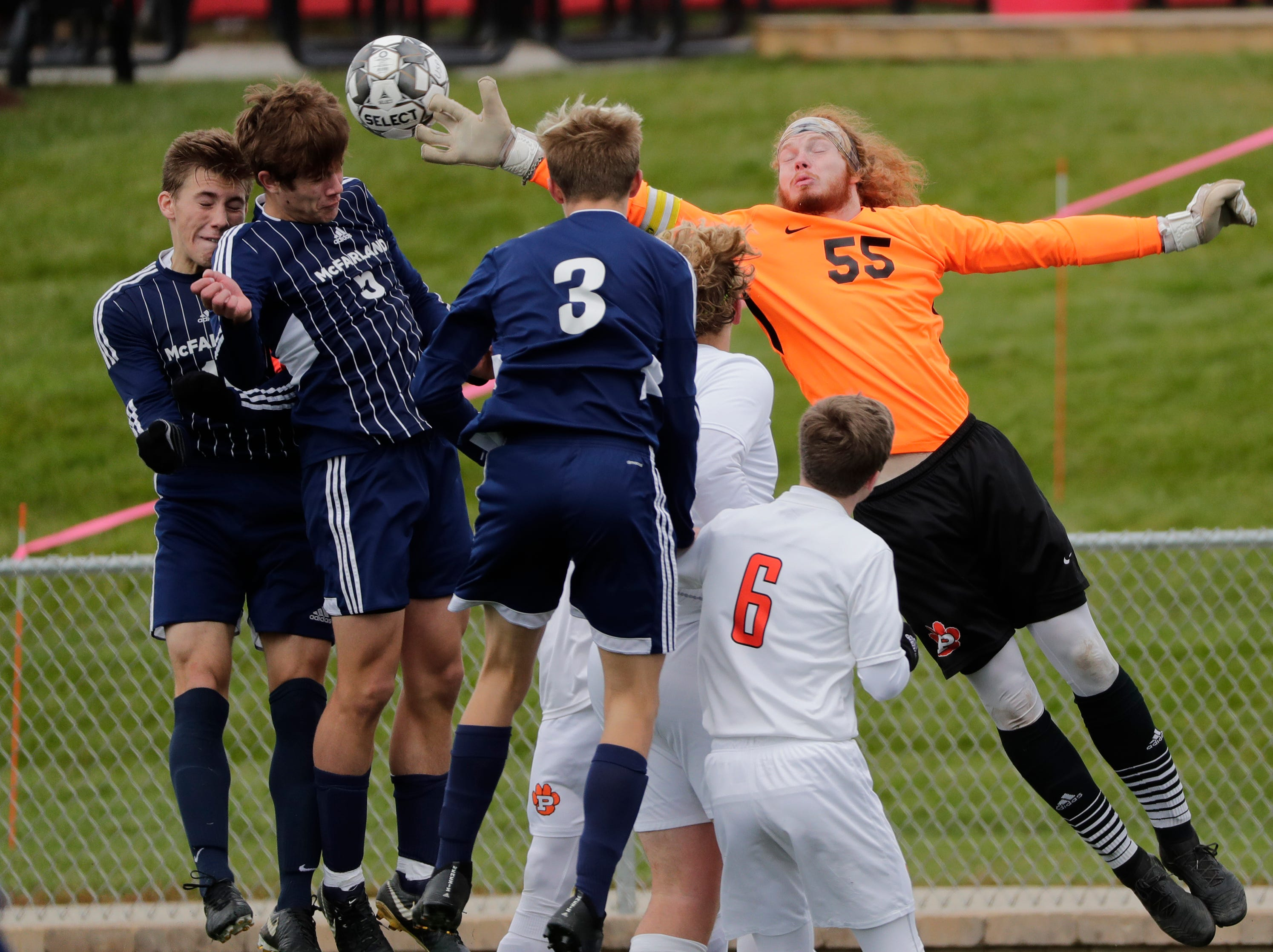 Plymouth High School's goalie Gabe Thull (55) defends on a head ball shot on goal by McFarland High School's Jackson Werwinski (5) during their WIAA Division 3 state semifinal boys soccer game Thursday, November 1, 2018, at Uihlein Soccer Park in Milwaukee, Wis. 