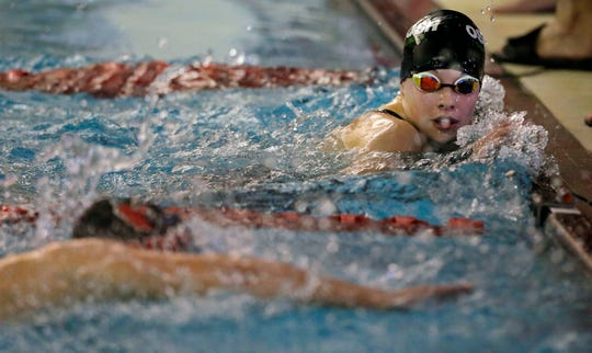Ali Pecore of Oshkosh North/Lourdes watches as Grace Sphatt of Fond du Lac finishes the 500-yard freestyle at a WIAA Division 1 swimming sectional meet at Neenah High School.