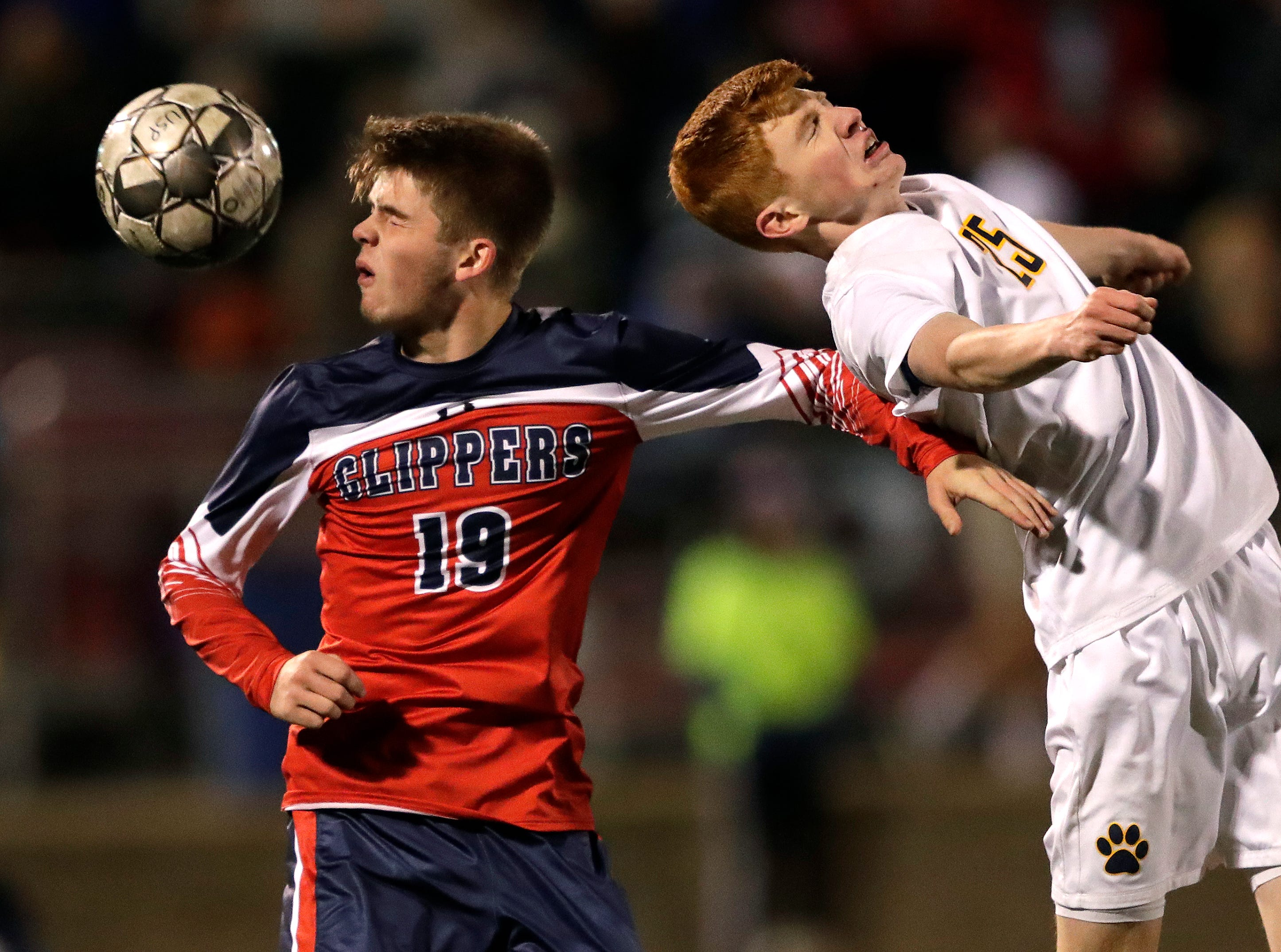 Sturgeon Bay High School's Owen Stevenson (19) goes up for a header against University School of Milwaukee's Bradshaw Morel (25) during their WIAA Division 4 state semifinal boys soccer game Friday, November 2, 2018, at Uihlein Soccer Park in Milwaukee, Wis. 