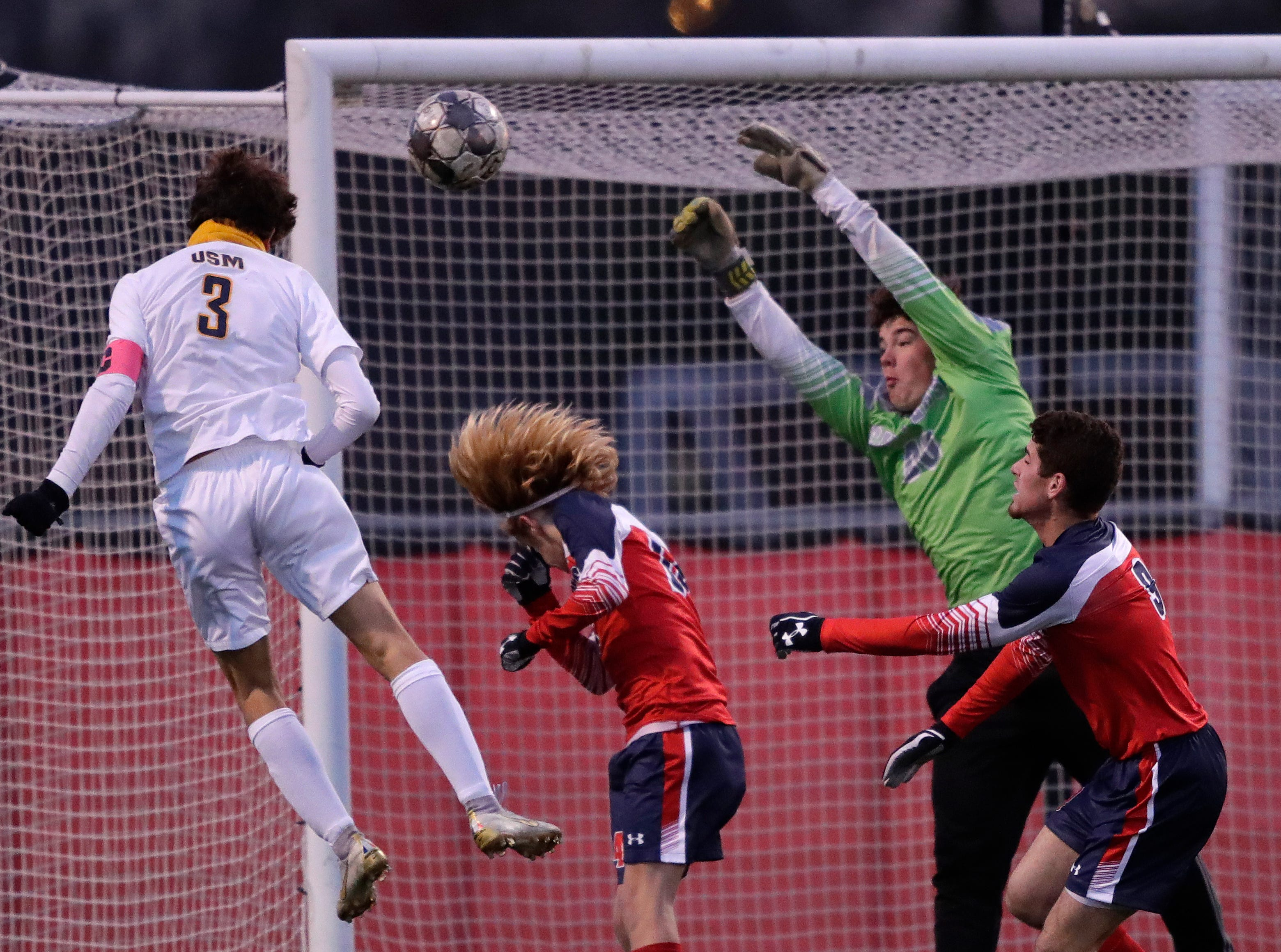 University School of Milwaukee's Matias Dermond (3) scores a goal on a header against Sturgeon Bay High School's goalie Oscar Polecheck (00) during their WIAA Division 4 state semifinal boys soccer game Friday, November 2, 2018, at Uihlein Soccer Park in Milwaukee, Wis. 