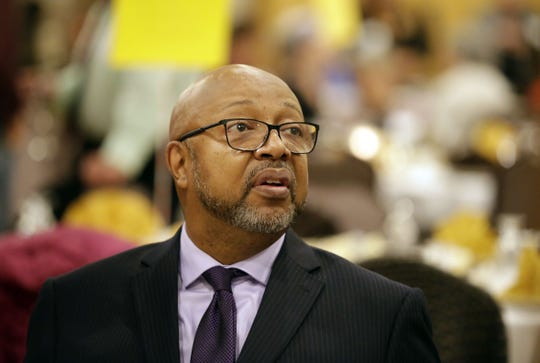 Journalist Leonard Pitts Jr. talks with guests before speaking at the 15th annual ESTHER banquet Sunday at Liberty Hall in Kimberly.