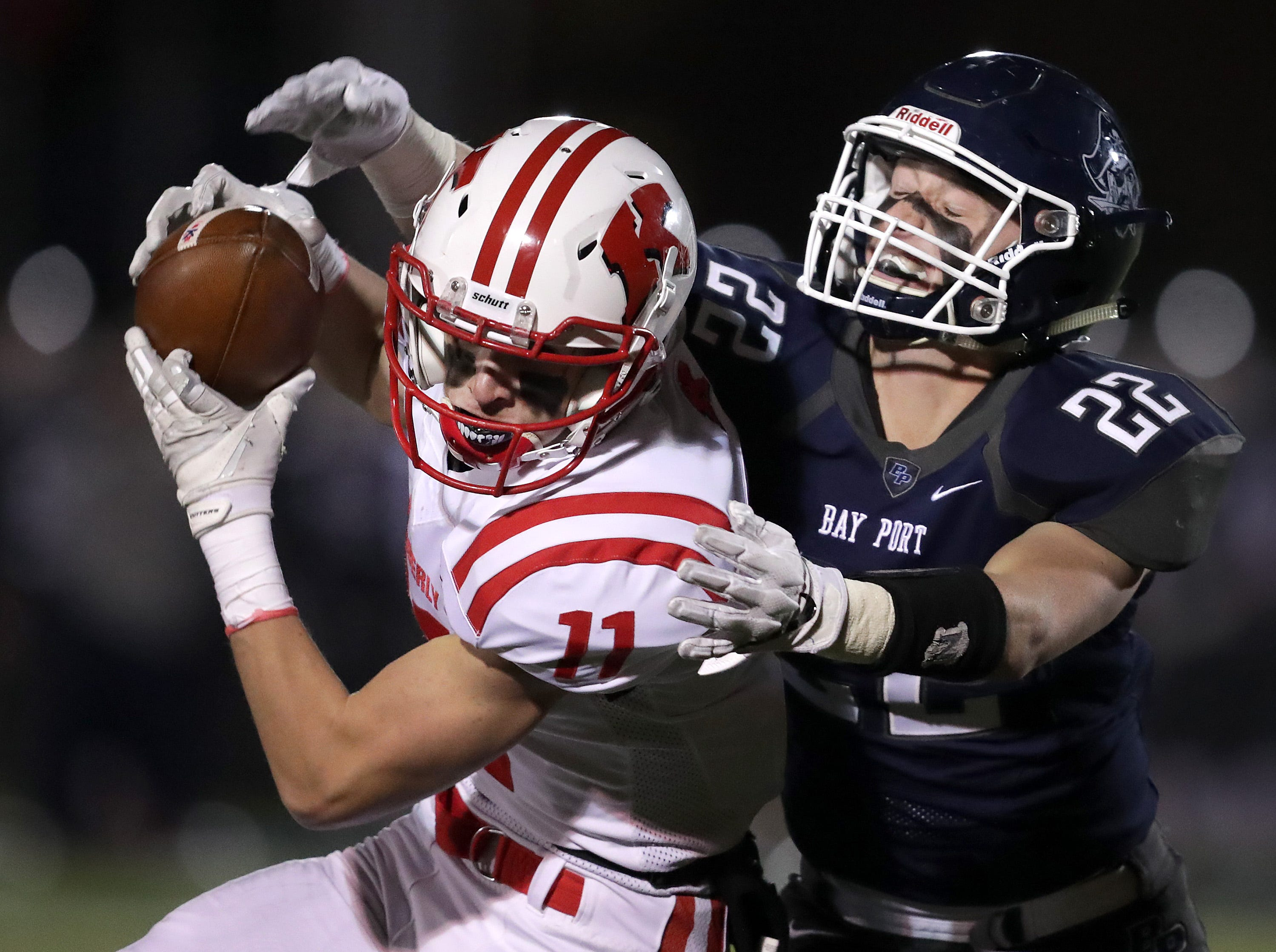 Kimberly High School's #11 Conner Wnek against Bayport High School's #22 Jake Berg during their WIAA Division 1 state quarterfinal football game on Friday, November 1, 2018, in Green Bay, Wis.  Kimberly defeated Bayport 38 to 20.