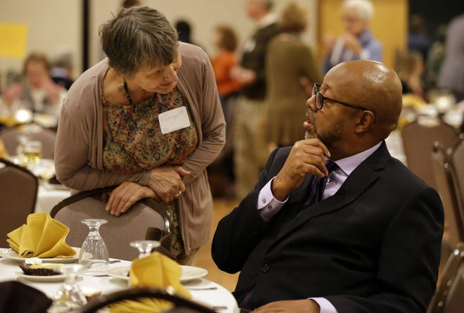 Sharyn Gawlick of Neenah talks with keynote speaker Leonard Pitts Jr. Sunday night at the 15th annual ESTHER banquet Liberty Hall in Kimberly.