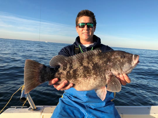 Kyle O'Connor holds a blackfish he caught on Nov. 4, 2018