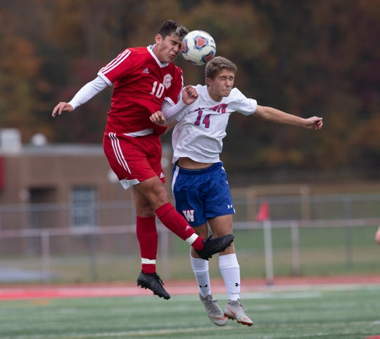 Ocean's Leonardo Montesinos battles for head ball with Wall's Samuel Gisoldi during first half action. Ocean Township Boys Soccer shuts out Wall in NJSIAA Central Group III boys soccer semifinal in Ocean Township on November 5, 2018.