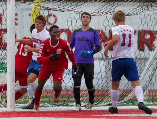 Ocean's Santieno Harding sticks out his toungue after scoring his team's second goal of game. Ocean Township Boys Soccer shuts out Wall in NJSIAA Central Group III boys soccer semifinal in Ocean Township on November 5, 2018.