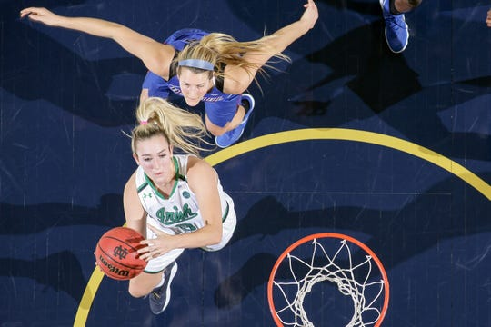 Two Shore Conference alums in action: Notre Dame guard Marina Mabrey (3) goes up for a shot against DePauk guard Kelly Campbell (20) in December of 2017.