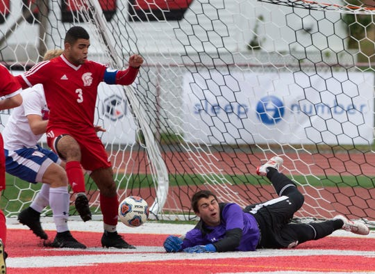 Ocean's James Schutz gets his foot on a loose ball in front of the goal but kicks it wide during first half action. He scored Oean's first goal early in the second half. Ocean Township Boys Soccer shuts out Wall in NJSIAA Central Group III boys soccer semifinal in Ocean Township on November 5, 2018.