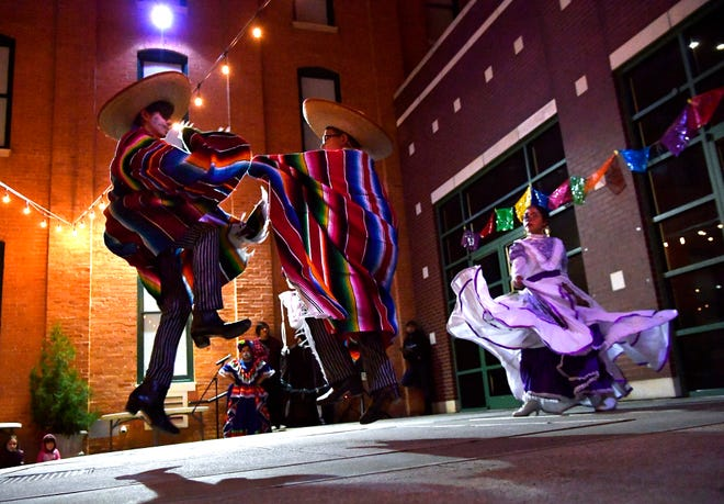 From left, Mateo Valdez, 14, David Lee Gott, 10, and Trinity Escobedo, 10, perform a traditional dance during The Grace Museum's Dia de los Muertos Family Night Thursday. The trio performed with Alma de Nuestras Raices Ballet Folklorico del Big Country.