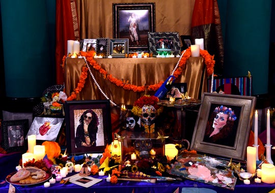 A community offrenda, an altar to honor departed ancestors, is set up on The Grace Museum's ballroom. The Grace held its Dia de los Muertos Family Night Thursday.