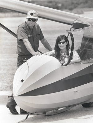 Jackie Cox, Dr. Jack Ramsey's niece, in a glider.
