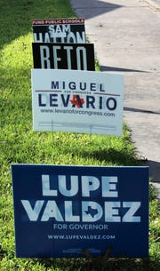Signs in this Abilene yard show support for Democrats running for office.