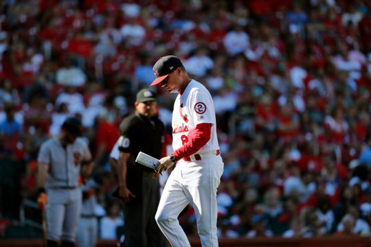 St. Louis Cardinals manager Mike Shildt walks back to the dugout after talking with umpires during a baseball game against the San Francisco Giants Sunday, Sept. 23, 2018, in St. Louis. (AP Photo/Jeff Roberson)
