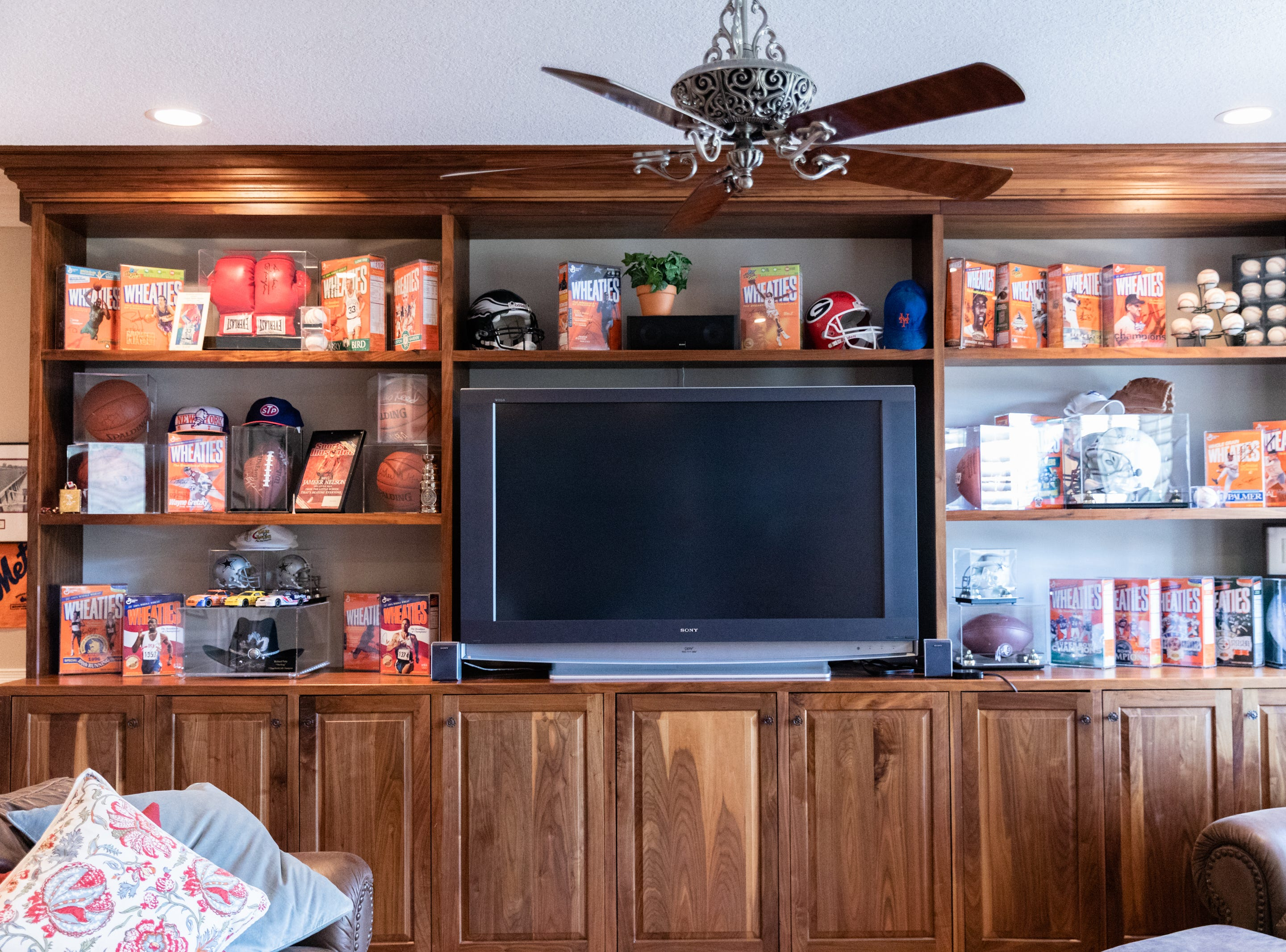 A collection of Wheaties boxes in the entertainment room in the basement of David Dudick's country estate, complete with guest house in Fletcher.