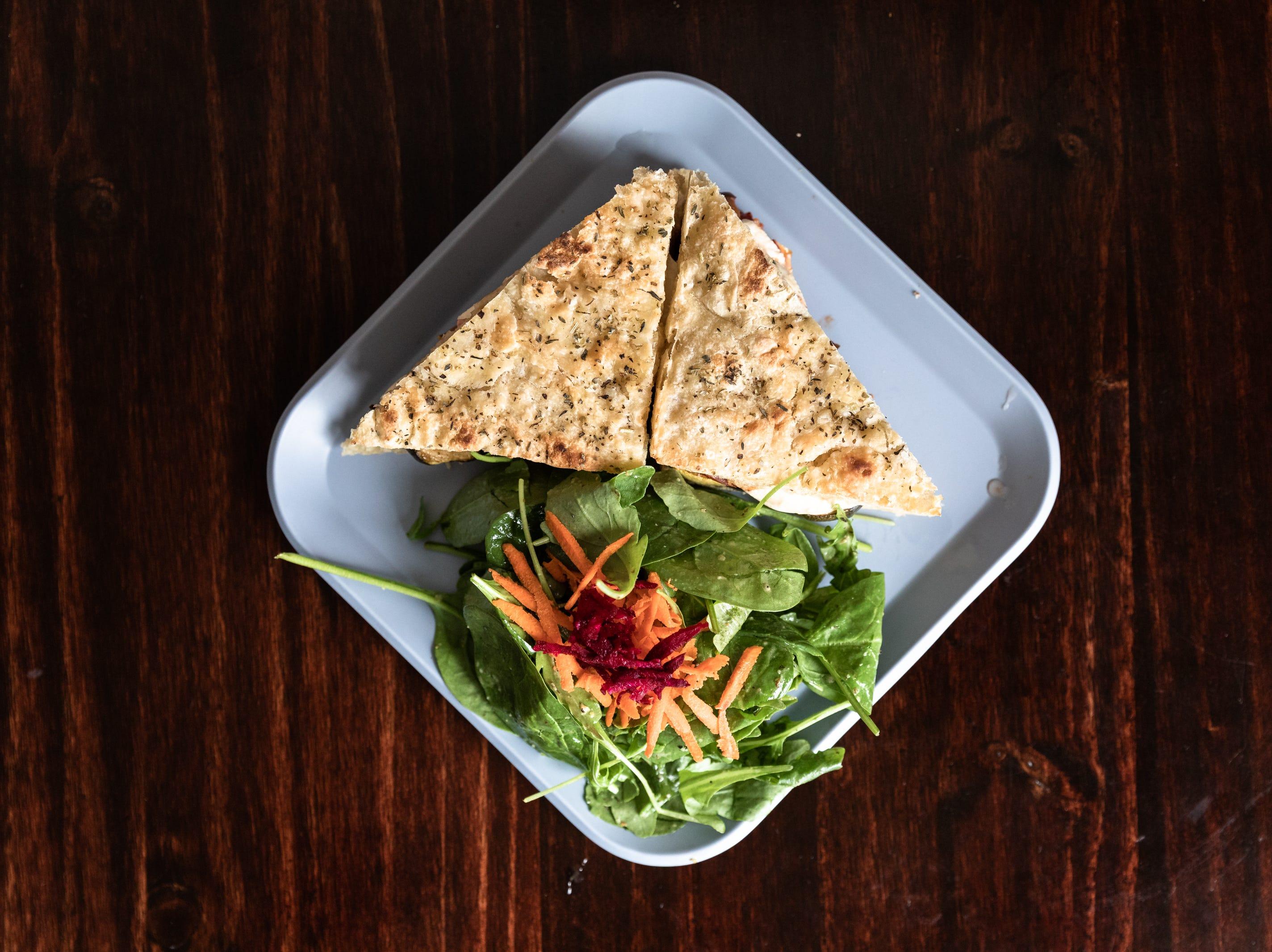 Simple Cafe & Juice Bar's roasted veggie sandwich with buffalo mozzarella, roasted eggplant, tomato, squash, zucchini, and peppered balsamic mayo.