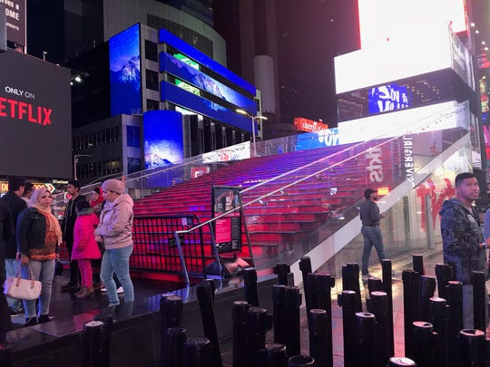 Beneath the red steps in times Square is the TKTS Discount Ticket Booth flagship location.