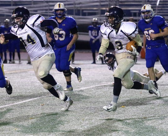 Kyreese Fisher runs behind the blocking of Ben Cook during Elmira Notre Dame's 38-20 win over Lansing in the Section 4 8-man football championship game Nov. 2, 2018 at Binghamton Alumni Stadium. Credit: Andrew Legare.