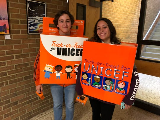 Spencer-Van Etten High School held its annual costume parade Oct. 31. The Key Club was collecting money for UNICEF during October, so Zach Huston and Jaylene Noviello dressed up as the iconic orange collection boxes that children have carried on Halloween for decades.