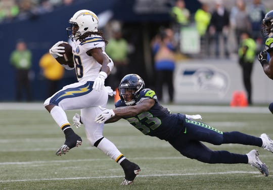 Seattle Seahawks' Tedric Thompson (33) lunges toward Los Angeles Chargers' Melvin Gordon.
