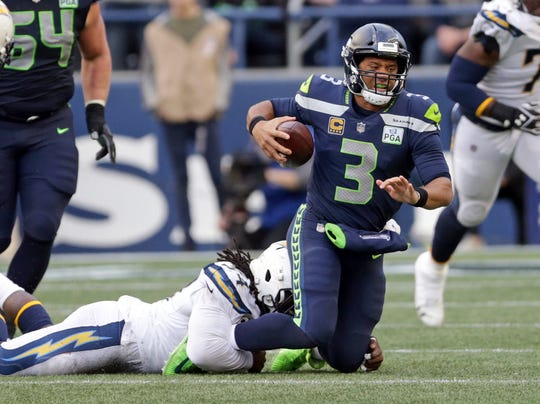 Seattle Seahawks quarterback Russell Wilson (3) is sacked by Los Angeles Chargers' Corey Liuget.