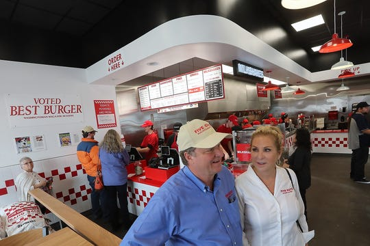 Owners Mike and Lisa Barnett talk about the grand opening of Five Guys Burgers and Fries in Silverdale on Monday.