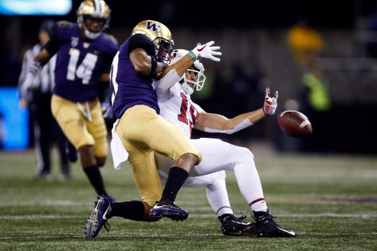 Washington defensive back Keith Taylor (27) breaks up a pass intended for Stanford receiver JJ Arcega-Whiteside on Saturday at Husky Stadium.