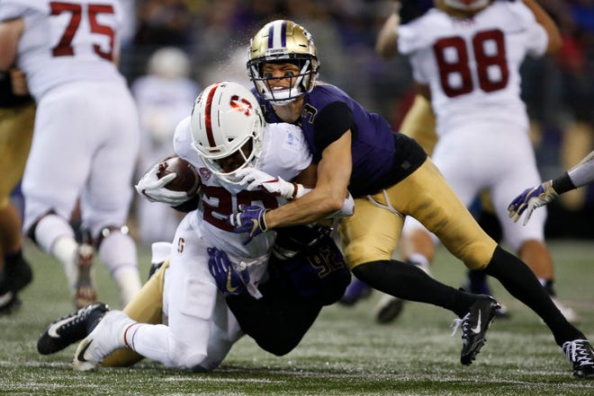 Elijah Molden of Washington helped stop running back Bryce Love of Stanford during the Huskies' win Saturday in Seattle.