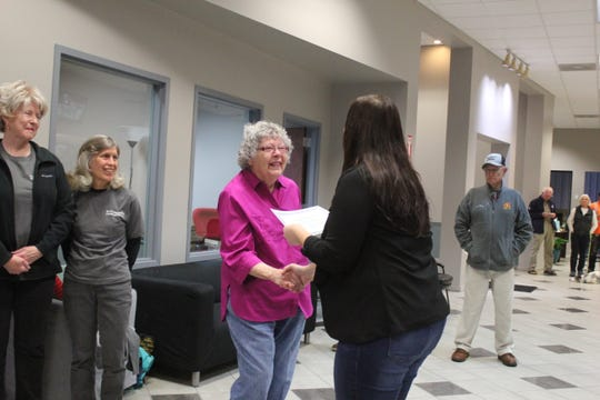 Elaine Loutzenheiser receives a certificate recognizing her completion of the first Citizens Academy from town clerk Angela Reece on Nov. 2.