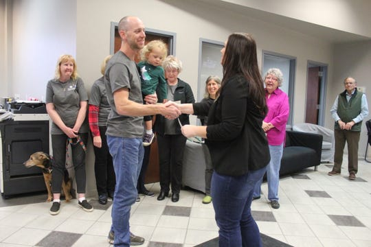 Michael Neder receives a certificate commemorating his completion of the first Citizens Academy from town clerk Angela Reece.