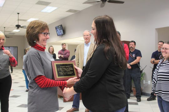 Susan Leive, left, presents town clerk Angela Reece with a plaque from the first Black Mountain Citizens Academy class thanking her for organizing the course.
