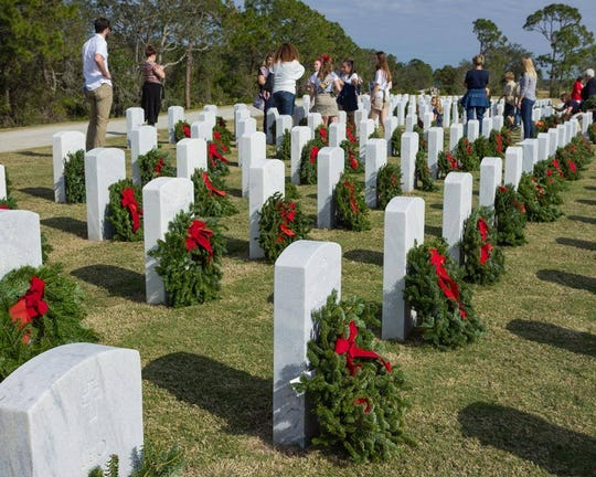 Volunteers laid Christmas wreaths at all 2,600-odd graves in 2017 at Cape Canaveral National Cemetery.